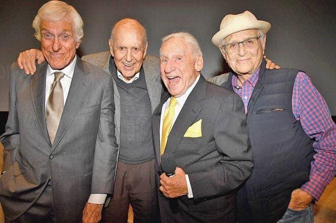 Dick Van Dyke, Carl Reiner, Mel Brooks, and Norman Lear standing together.